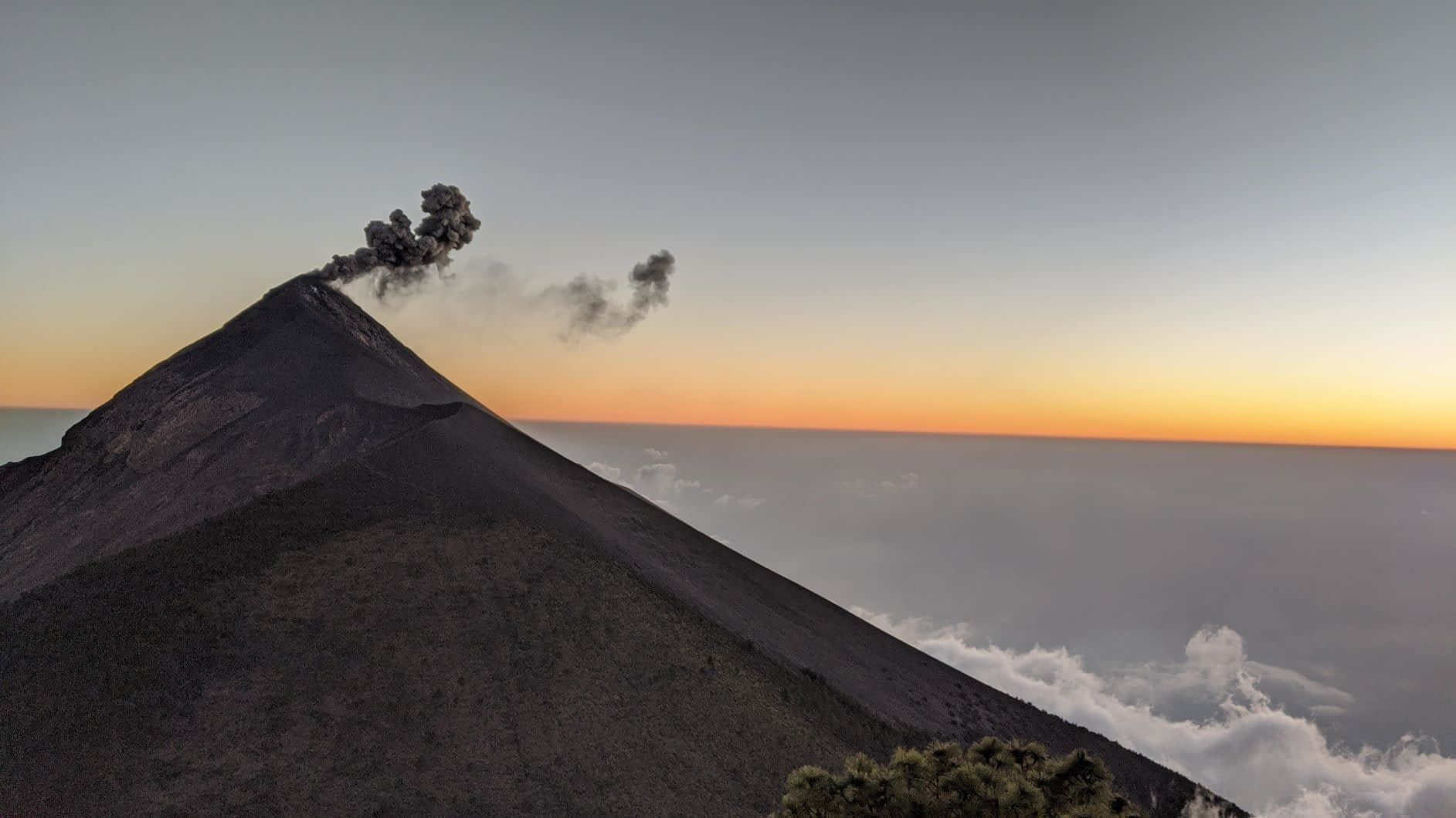 Fuego Volcano spewing ash at sunset