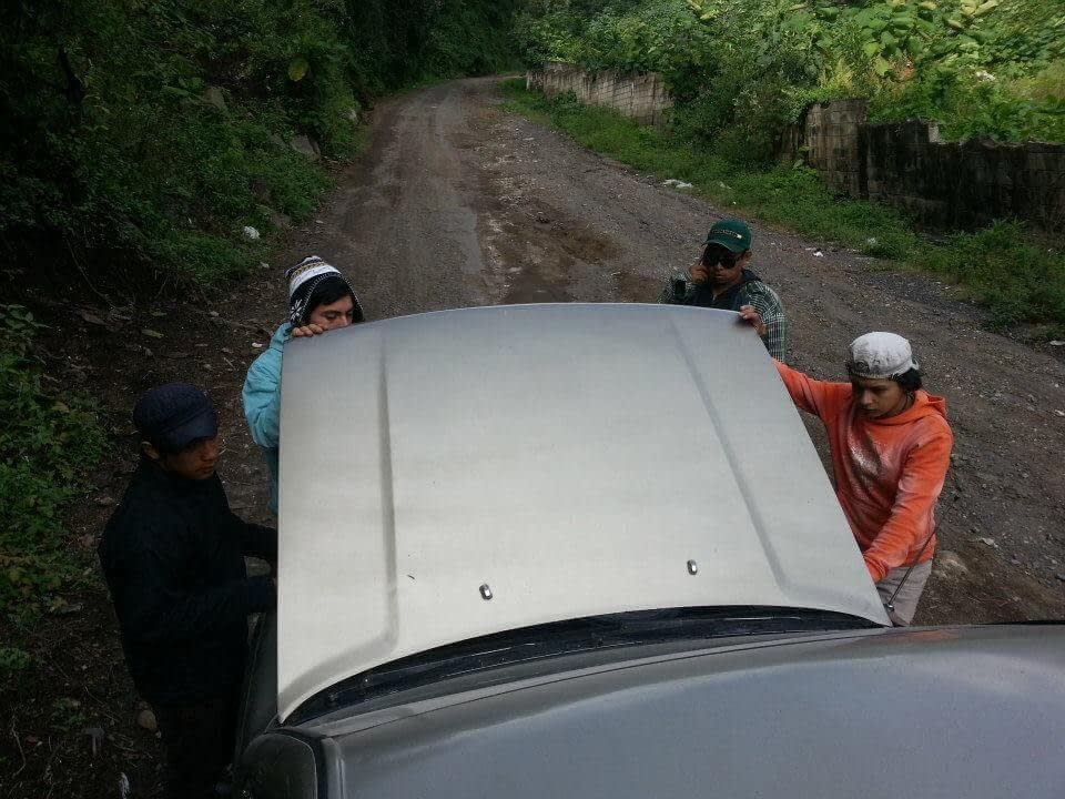 Trying to fix a truck on a dirt road in Guatemala