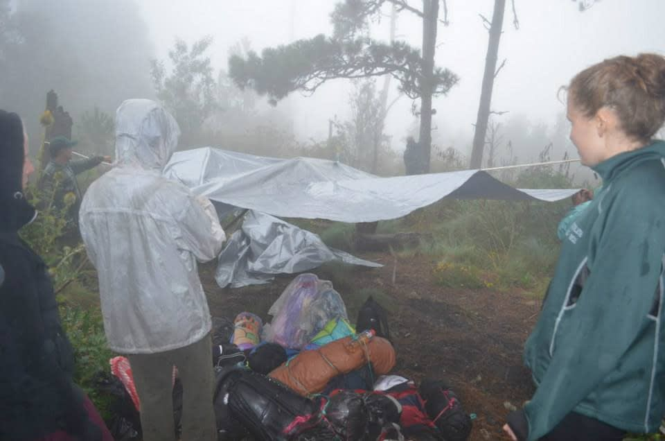 Setting up a tarp to cover our gear at volcano acatenango