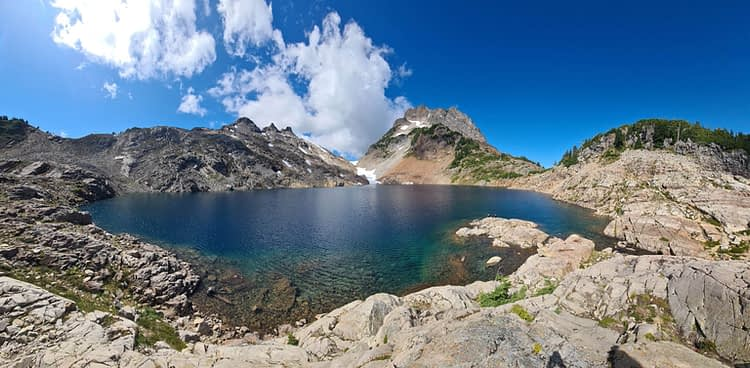 a panoramic view of Foggy lake just outside Gothic Basin