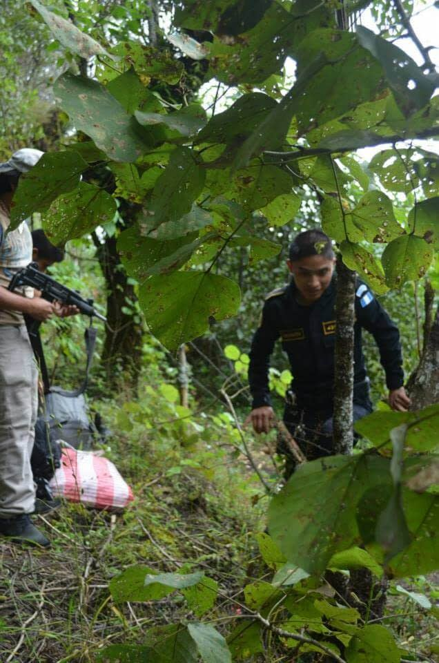holding the barbed wire fence for the police officer hiking Acatenango
