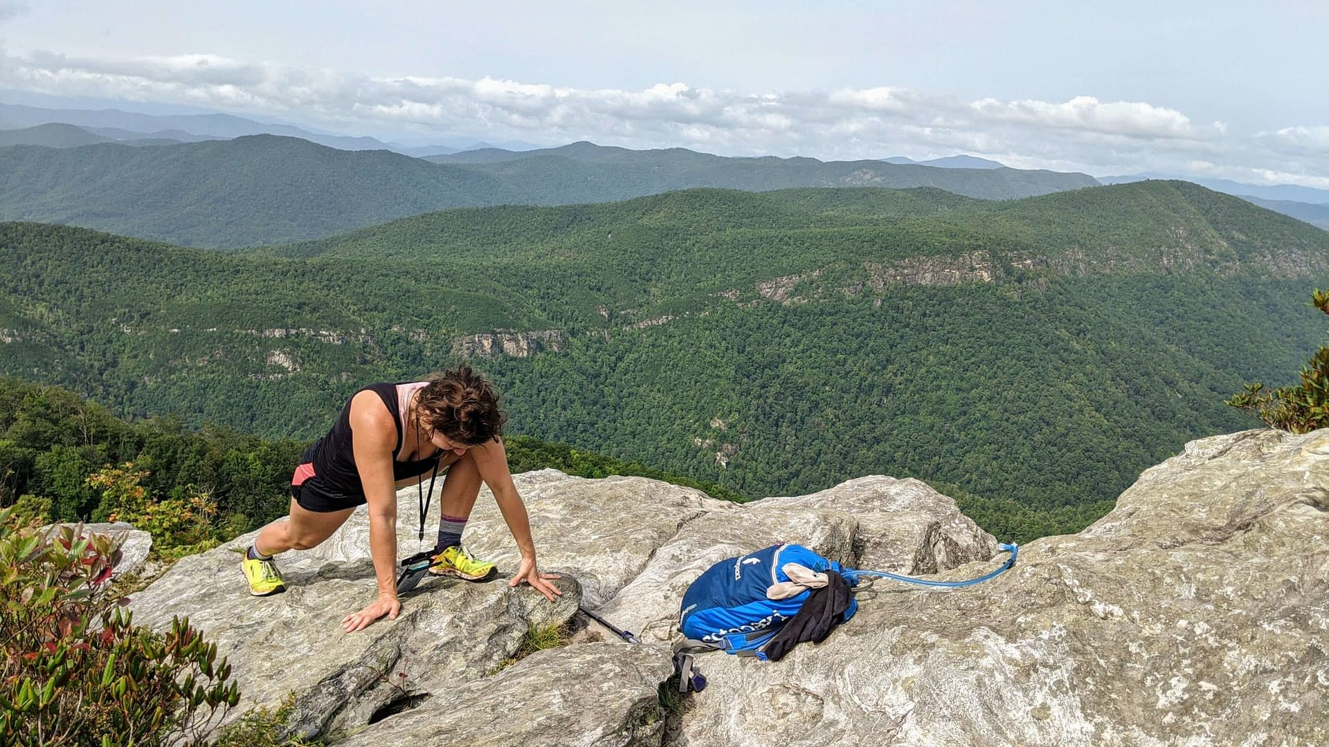 taking a stretch break on top of table rock at linville gorge