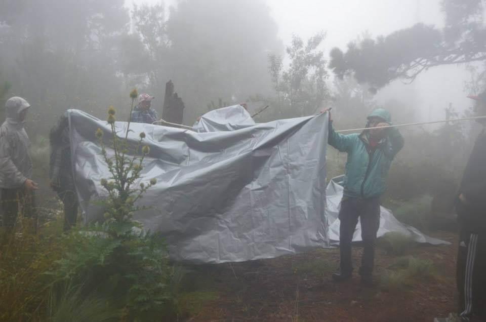 Setting up the tarp for a tent at Acatenango Volcano