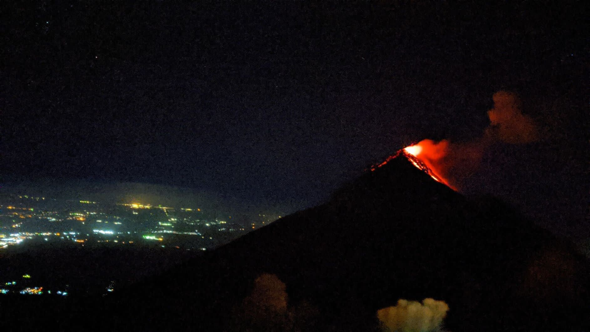 Fuego spewing lava view from acatenango volcano at night